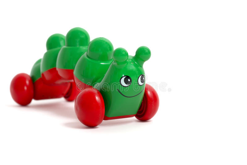 被隔绝的绿色毛虫玩具 免版税库存照片
