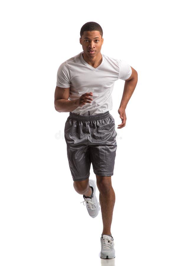 被隔绝的年轻非裔美国人赛跑者室内 免版税库存照片