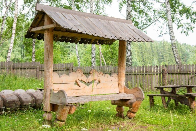 被雕刻的长木凳,常用在农村 图库摄影