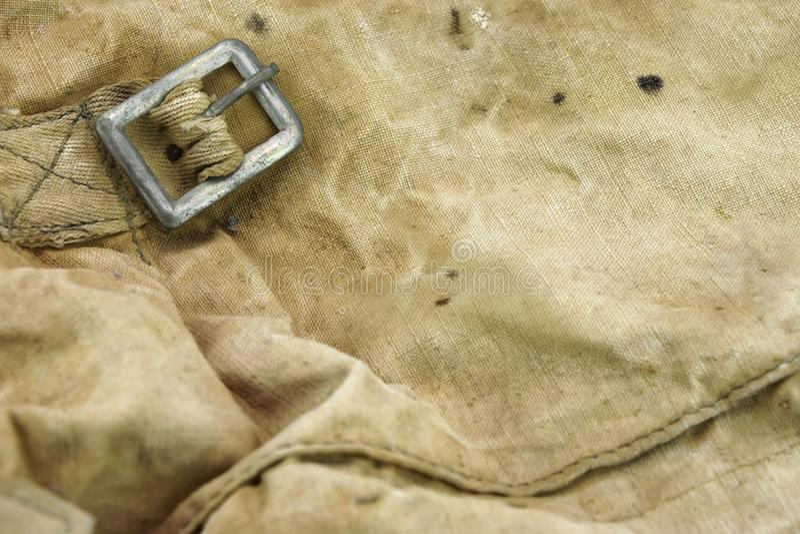 被风化的军事帆布袋子织地不很细背景 免版税库存图片