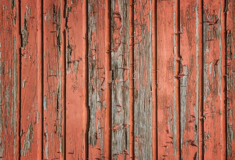 被风化的土气红色木板条背景 库存图片
