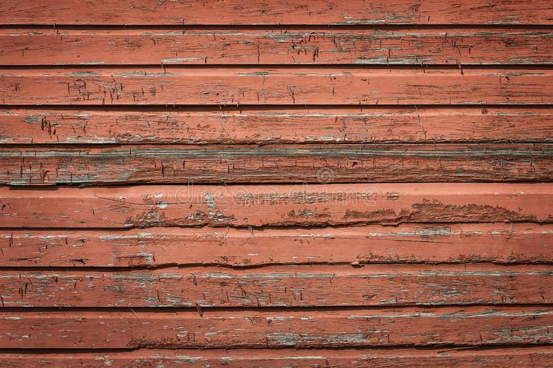 被风化的土气红色木板条背景 库存照片