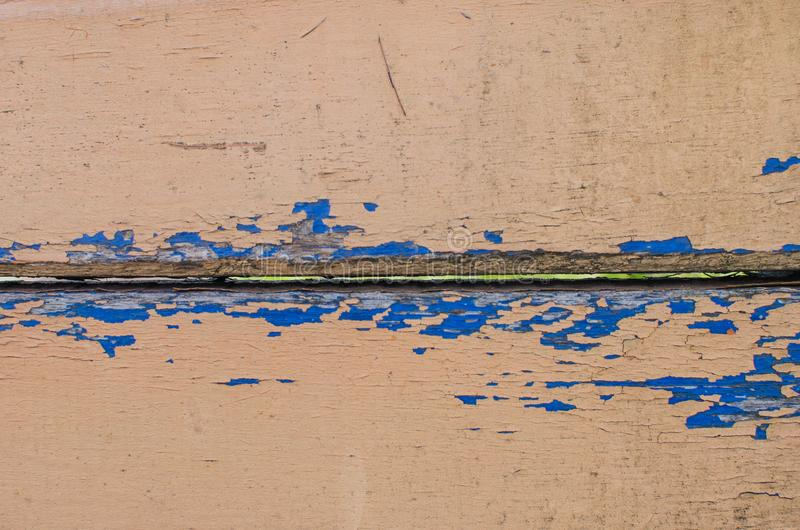 被风化的木头背景装缨球油漆 r 免版税库存照片