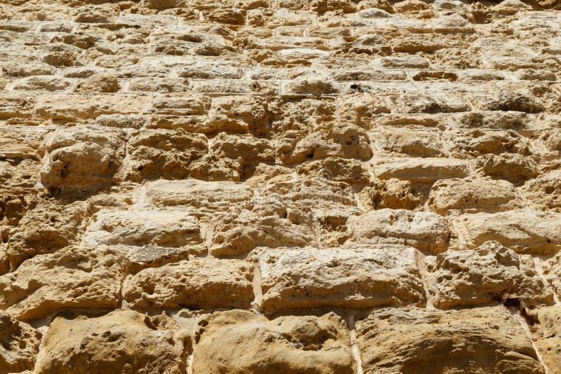 被风化的石灰石纹理背景,块做巨大的石墙堡垒城堡  库存照片