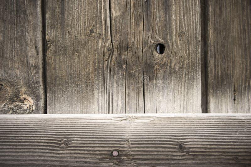 被风化的谷仓墙壁木五谷板条结钉子 免版税库存图片