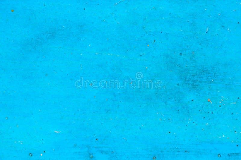 被绘的蓝色油漆帆布背景 库存图片
