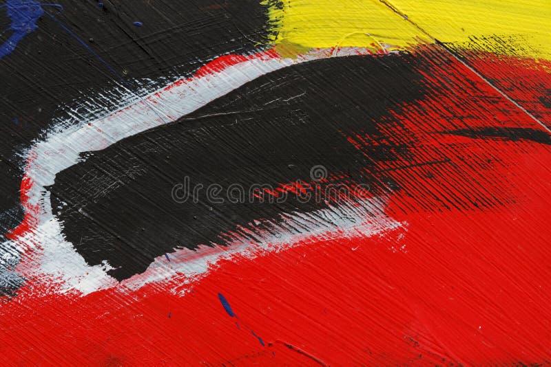 被绘的金属墙壁的小零件有黑色、红色黄色和丝毫的 免版税图库摄影