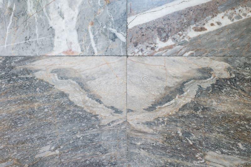 被仿造的大理石(看起来蝴蝶),大理石纹理地板 免版税库存照片
