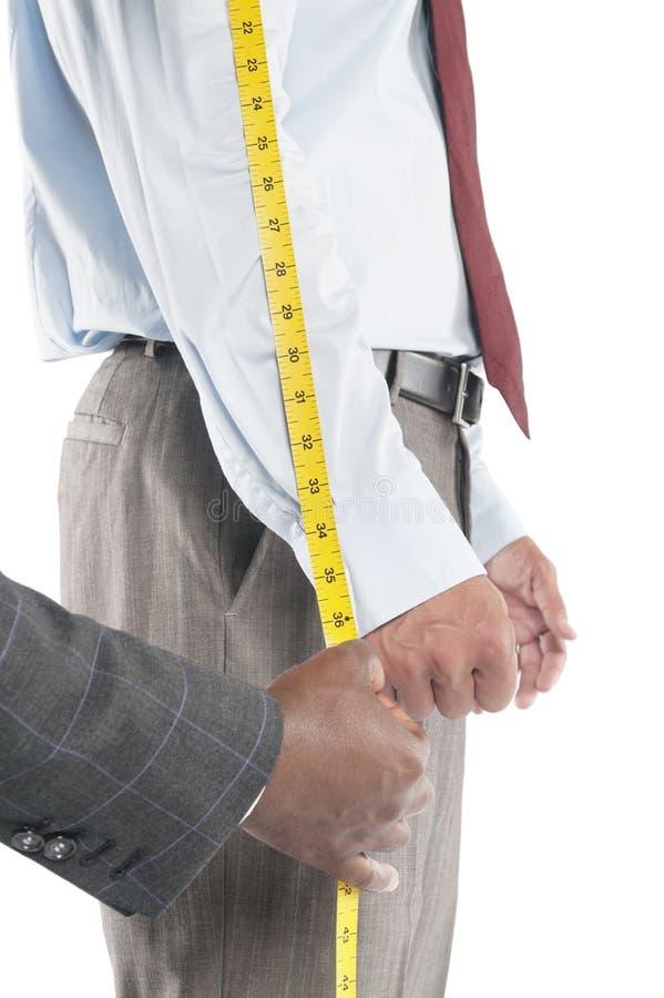 裁缝测量的衬衣的袖子 免版税库存图片