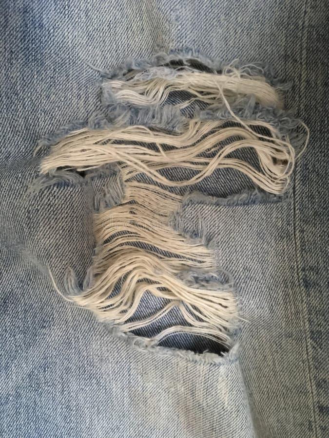 裂口牛仔裤 免版税库存图片