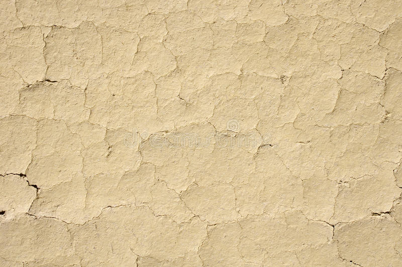 破裂的泥膏药墙壁特写镜头 库存照片