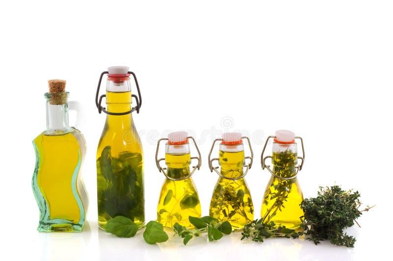 装瓶草本油橄榄 免版税库存图片