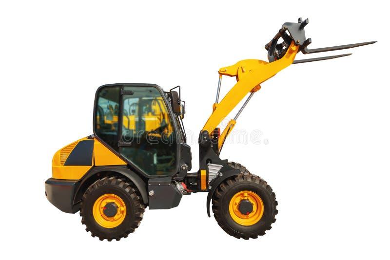 装载者或铲车建筑卡车隔绝与裁减路线 库存图片