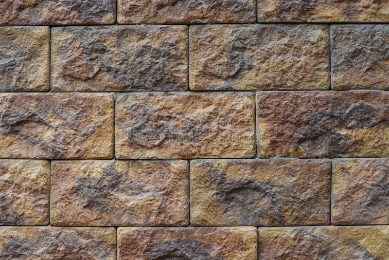 装饰石墙纹理bacground样式,自然颜色 免版税库存照片