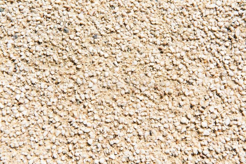装饰膏药粒状纹理  微小的在水泥或混凝土的五谷小的石头 葡萄酒装饰 粒状墙壁 免版税库存图片