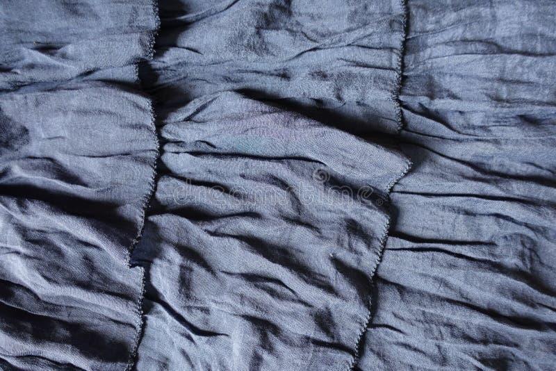 装饰衣裙3行在蓝色织品的 免版税库存图片