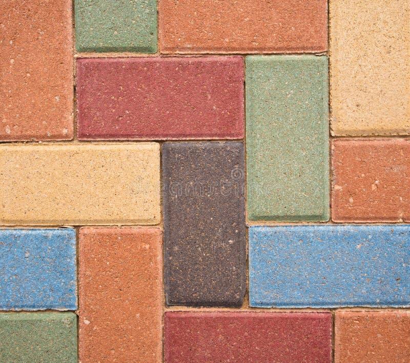 装饰色的砖背景 图库摄影