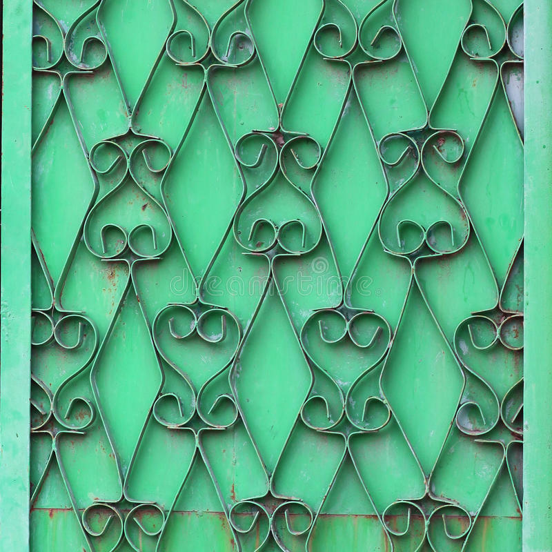装饰锻铁绿色墙壁难看的东西织品 免版税图库摄影