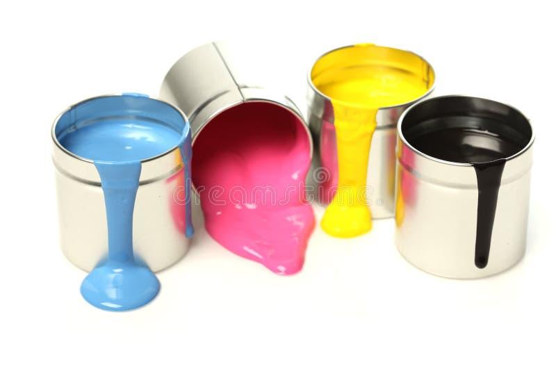 装cmyk油漆于罐中 免版税库存图片