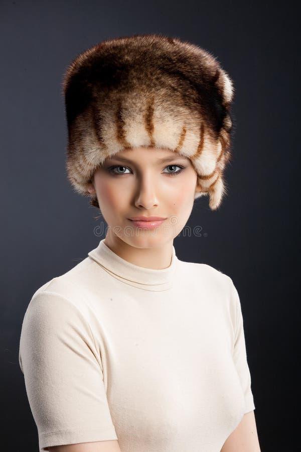 裘皮帽妇女 图库摄影