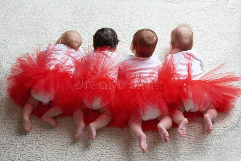 裙子芭蕾舞女演员背面图的宝贝 免版税库存照片