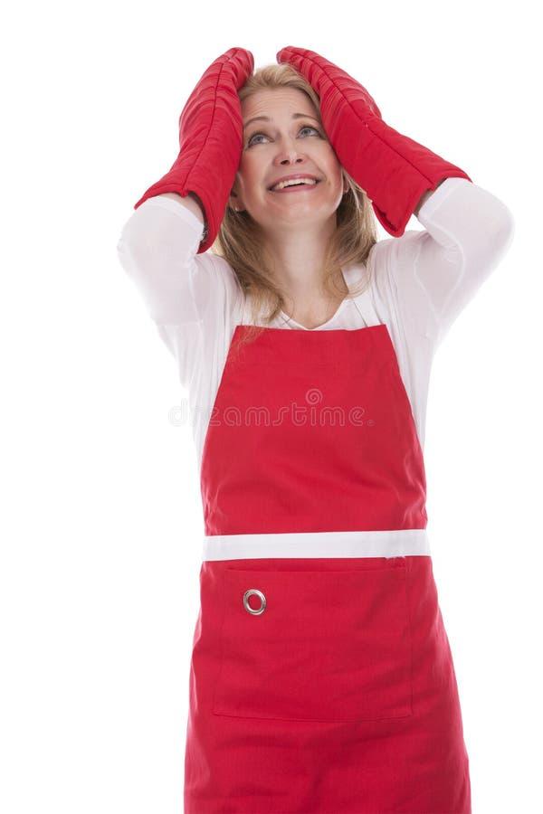 围裙的女性厨师 免版税库存照片