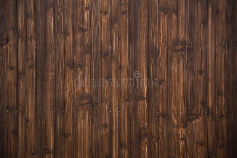 黑褐色木板条纹理背景 免版税库存图片