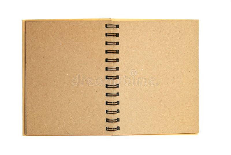 褐色查出开放纸张回收的笔记本 免版税库存照片