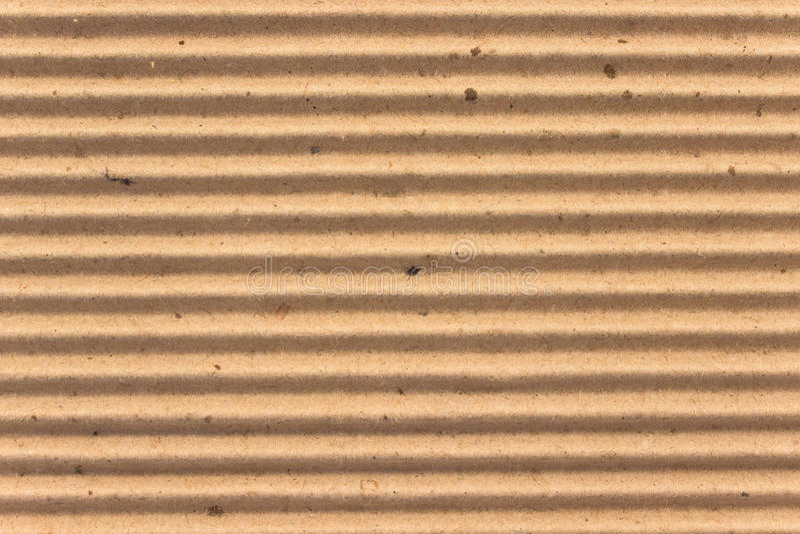 褐色纹理使纸板成波状作为背景 免版税图库摄影