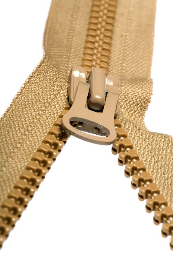 褐色解压缩的拉链 免版税库存图片