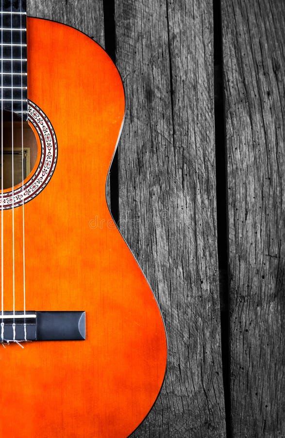 西班牙吉他木头背景 免版税库存图片