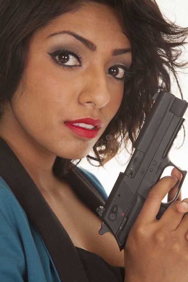 西班牙妇女关闭枪神色 库存图片