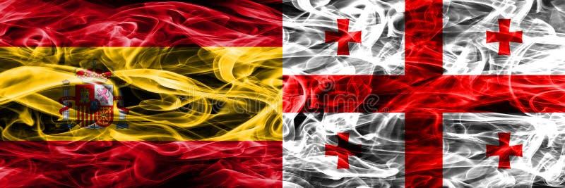 西班牙对乔治亚肩并肩被安置的烟旗子 浓厚上色 免版税图库摄影