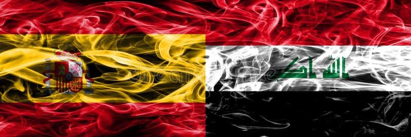 西班牙对伊拉克肩并肩被安置的烟旗子 厚实的色的sil 库存照片