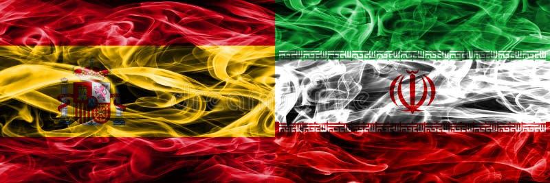 西班牙对伊朗肩并肩被安置的烟旗子 厚实的色的sil 免版税库存照片