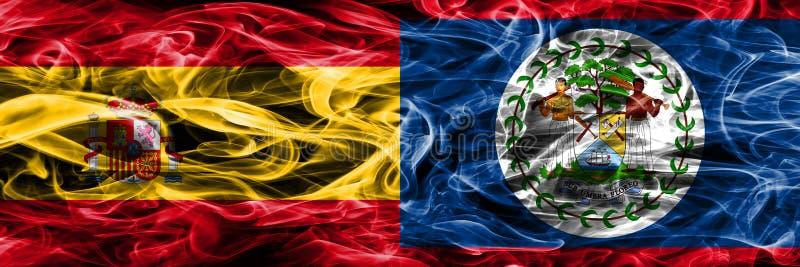 西班牙对伯利兹肩并肩被安置的烟旗子 重色的s 免版税库存图片