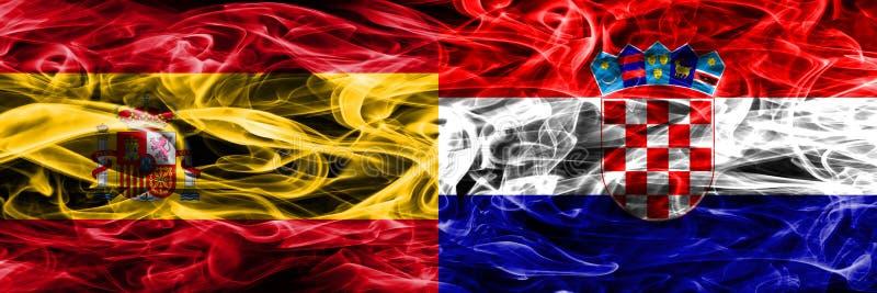 西班牙对克罗地亚肩并肩被安置的烟旗子 浓厚上色 免版税图库摄影