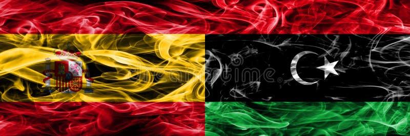 西班牙对利比亚肩并肩被安置的烟旗子 厚实的色的si 库存照片