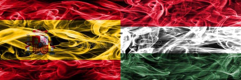 西班牙对匈牙利肩并肩被安置的烟旗子 浓厚上色 免版税库存照片