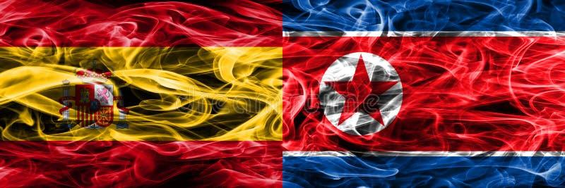 西班牙对北朝鲜肩并肩被安置的烟旗子 厚实的colo 库存图片