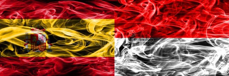 西班牙对印度尼西亚肩并肩被安置的烟旗子 厚实的colore 库存图片