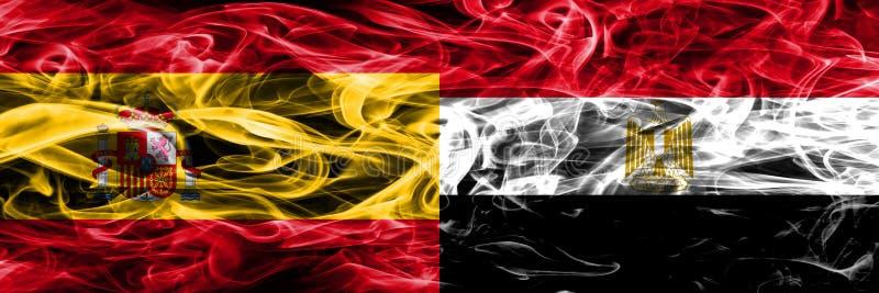 西班牙对埃及肩并肩被安置的烟旗子 厚实的色的si 库存照片