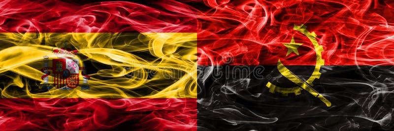 西班牙对安哥拉肩并肩被安置的烟旗子 重色的s 库存照片