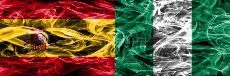 西班牙对尼日利亚肩并肩被安置的烟旗子 浓厚上色 免版税库存图片