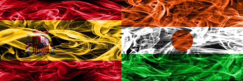 西班牙对尼日尔肩并肩被安置的烟旗子 厚实的色的si 库存图片