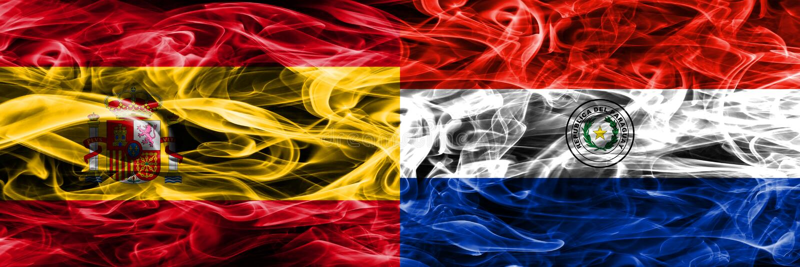 西班牙对巴拉圭肩并肩被安置的烟旗子 浓厚上色 图库摄影