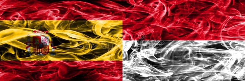 西班牙对摩纳哥肩并肩被安置的烟旗子 重色的s 免版税库存图片