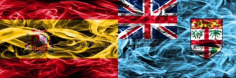 西班牙对斐济肩并肩被安置的烟旗子 厚实的色的sil 免版税库存照片
