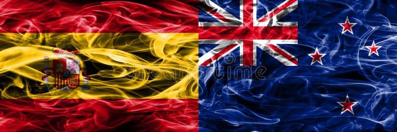 西班牙对新西兰肩并肩被安置的烟旗子 厚实的colo 图库摄影