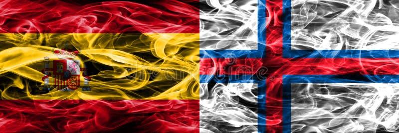 西班牙对法罗群岛肩并肩被安置的烟旗子 厚实的co 库存图片